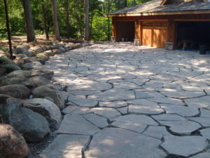 As straight forward as it gets. This is a large driveway that has been built out of 6 inch thick giant flagstone.